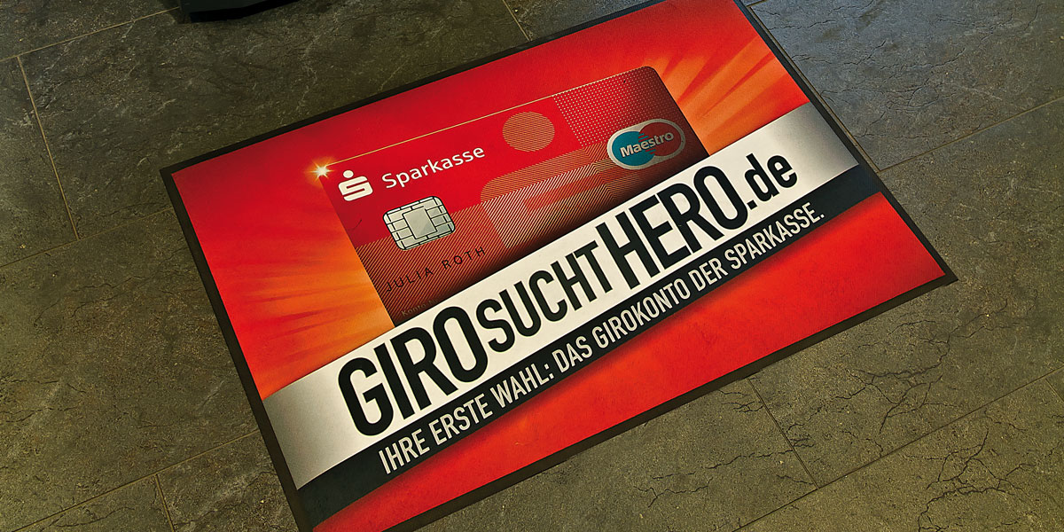 "Ad-Mat Floormat - custom mat advertising Sparkasse ""Giro sucht Hero"" banking services"