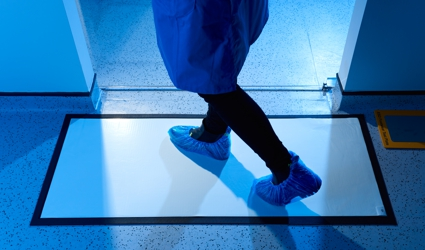 Sticky-Step anti-bacterial barrier matting with cart and medical staff