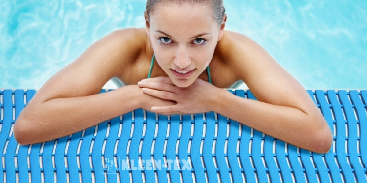 Girl in swimming pool leaning on Kleen-Wave safety mat